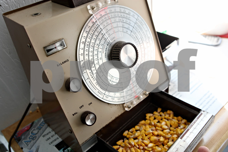 Rob Winner – rwinner@daily-chronicle.com<br /> <br /> This machine, called a moisture tester, measures the moisture content of corn for farmers. If the corn contains too much water the farmers must wait to harvest.<br /> 10/07/2009