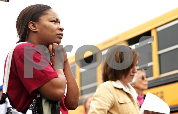 Beck Diefenbach  -  bdiefenbach@daily-chronicle.com<br /> <br /> Deven Rainey, of DeKalb, listens as parents and teachers speak during the rally  for child care providers and other social services demonstrating at the office of Illinois State Representative Robert Pritchard in Sycamore, Ill., on Thursday June 11, 2009. Rainey's daughter attends the Children's Learning Center.