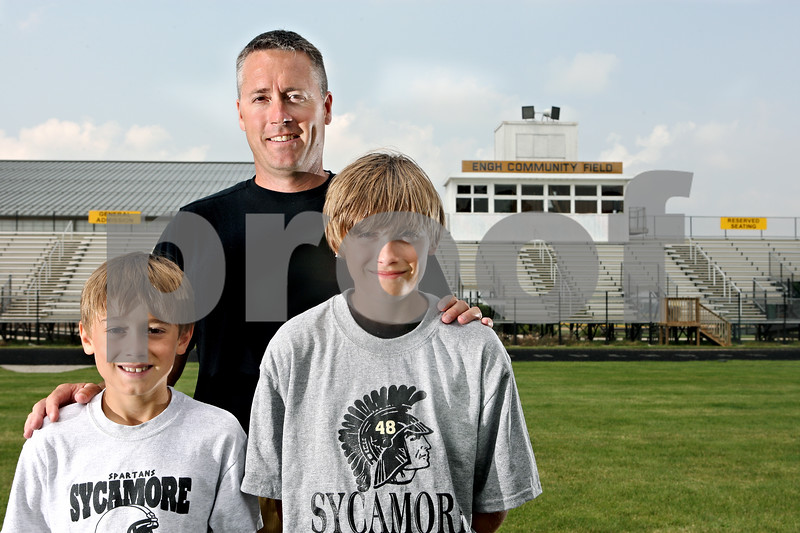 Rob Winner – rwinner@daily-chronicle.com<br /> Sycamore coach Joe Ryan and sons Luke (left), 9, and Jackson, 11.<br /> 07/22/2009