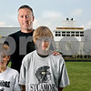 Rob Winner – rwinner@daily-chronicle.com<br /> Sycamore coach Joe Ryan and sons Luke (left), 9, and Jackson, 11.<br /> 07/22/2009