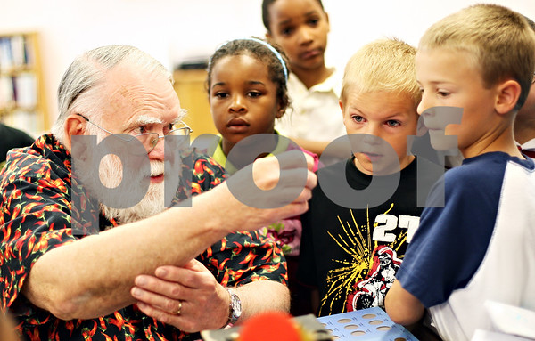 Beck Diefenbach  -  bdiefenbach@daily-chronicle.com<br /> <br /> Homer Grady, of DeKalb, shows off a century old silver dollar to a group of second graders from Brooks School during a show and tell at the DeKalb Senior Center in DeKalb, Ill., on Thursday May 28, 2009.