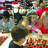 Beck Diefenbach  -  bdiefenbach@daily-chronicle.com<br /> <br /> Second grader Kayli Hilliard, far right, and fifth grader Molly Paquette work together during chess club at Tyler Elementary School in deKalb, Ill., on Monday Dec. 7, 2009.