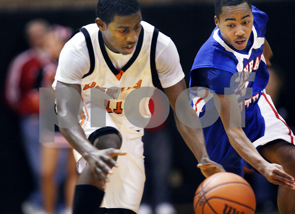 Beck Diefenbach  -  bdiefenbach@daily-chronicle.com<br /> <br /> DeKalb's Darius McNeal (11) and Glenbard South's Ralondo Schumate (3) leap for a loose ball during the third quarter of the game at DeKalb High School in DeKalb, Ill., on Friday Feb. 13, 2009.