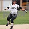 Beck Diefenbach  -  bdiefenbach@daily-chronicle.com<br /> <br /> Kaneland's Jordan Herra (29) completes a double during the third inning of the game against Hampshire at Burlington Central High School in Burlington, Ill., on Thursday May 28, 2009.