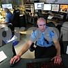 Rob Winner – rwinner@daily-chronicle.com<br /> Jeremiah Wilson focuses on one of five monitors in front of his work station within the telecommunications center at the DeKalb Police Department on Monday October 26, 2009.