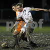Rob Winner – rwinner@daily-chronicle.com<br /> In the second half, DeKalb's Eric Galvan (left) and Freeport's Jared Brendemuehl become entangled during the IHSA Class 2A Freeport Sectional at Belvidere on Friday October 30, 2009. DeKalb lost to Freeport, 1-0.