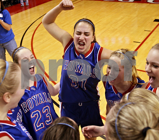Beck Diefenbach – bdiefenbach@daily-chronicle.com<br /> <br /> Hinckley-Big Rock guard Alyssa Baunach (23), Bianca Edmeier (31) and Maxzine Rossler (22) celebrate with their team after defeating Ridgeview High School in the Class 1A Girls Basketball Semi-Final game at the Red Bird Arena in Normal, Ill., on Friday Feb. 27, 2009.