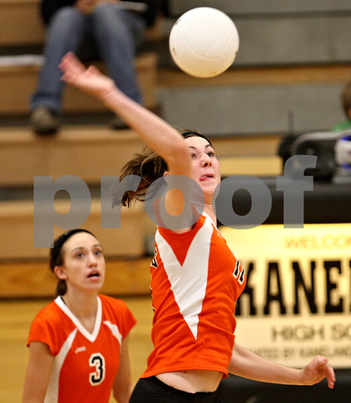 Beck Diefenbach – bdiefenbach@daily-chronicle.com<br /> <br /> DeKalb's Emily Bemis (11) returns the ball during the first period of the game against Kaneland at Kaneland High School in Maple Park, Ill., on Saturday Sept. 19, 2009.