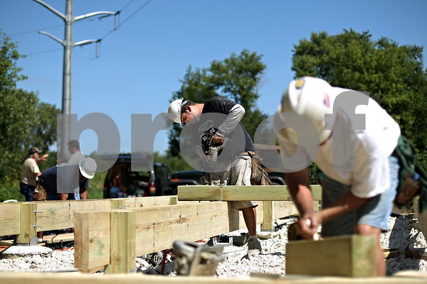 Beck Diefenbach  -  bdiefenbach@daily-chronicle.com<br /> <br /> Carpenter Joe Parashis, center, of David Wayne Carpenter Contractors helps build a scenic overlook deck at the new Larson Park in Sycamore, Ill., on Tuesday Sept. 1, 2009.