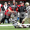 Rob Winner – rwinner@daily-chronicle.com<br /> Northern tight end Reed Cunningham is able to wrestle a Harnish pass away from Western Michigan safety Mario Armstrong during a Huskie drive in the first half. Northern Illinois went on to defeat Western Michigan 38-3 on Saturday.<br /> 10/03/2009