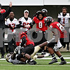 Rob Winner – rwinner@daily-chronicle.com<br /> Northern cornerback Kiaree Daniels (23) intercepts a pass intended for Western Michigan wide receiver Ansel Ponder during the first half. Northern Illinois went on to defeat Western Michigan 38-3 on Saturday.<br /> 10/03/2009