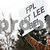 "Beck Diefenbach  -  bdiefenbach@daily-chronicle.com<br /> <br /> Caleb Flex, 12, of Waterman, holds a sign asking for the wind farm developer Florida Power and Light to ""let Lee be"" during an anti-wind farm protest on the corner of County Line Road and Lee Road in Lee, Ill., on Saturday Oct. 24, 2009."