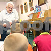 Beck Diefenbach  -  bdiefenbach@daily-chronicle.com<br /> <br /> Henry Wolfe, of Sycamore, tells stories of using an out house and attending a two-room school house to a group of second graders from Brooks School during a show and tell at the DeKalb Senior Center in DeKalb, Ill., on Thursday May 28, 2009.