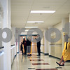 Beck Diefenbach  -  bdiefenbach@daily-chronicle.com<br /> <br /> A graduating senior waits in the hallway at Sycamore High School in Sycamore, Ill., on Sunday May 31, 2009.