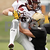 Beck Diefenbach  -  bdiefenbach@daily-chronicle.com<br /> <br /> Montini wide receiver Jordan Westerkamp (81, left) completes a pass as he is taken down by Sycamore defensive back Eric Ray (5) during the first quarter of the playoff game at Sycamore High School in Sycamore, Ill., on Saturday Nov. 14, 2009.
