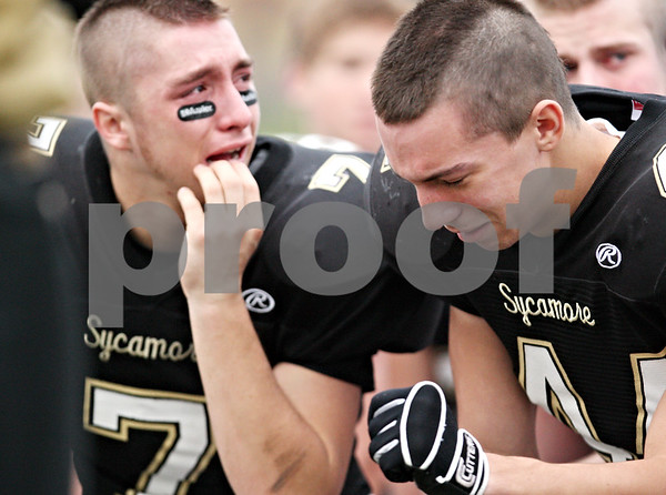 Beck Diefenbach  -  bdiefenbach@daily-chronicle.com<br /> <br /> Sycamore's Josh Butkus (44, right) and Danny Schroeder (7) react to their team's loss to Montini following the playoff game at Sycamore High School in Sycamore, Ill., on Saturday Nov. 14, 2009.