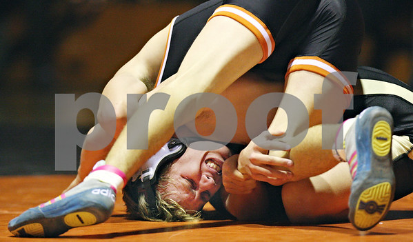 Beck Diefenbach  -  bdiefenbach@daily-chronicle.com<br /> <br /> Sycamore's Jeff Flanigan gets stuck in a tight spot by DeKalb's Jake Jones during the 125 weight class match at DeKalb High School in DeKalb, Ill., on Thursday Jan. 22, 2009.