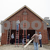 Beck Diefenbach – bdiefenbach@daily-chronicle.com<br /> <br /> DeKalb and Sycamore High School students prepare to work on the exterior of the project house in Sycamore, Ill., built in the construction trades class through the Kishwaukee Education Consortium on Tuesday March 10, 2009.