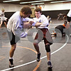 Beck Diefenbach  -  bdiefenbach@daily-chronicle.com<br /> <br /> DeKalb's Tyler Larson (center right) trips up teammate Doug Johnson during practice at DeKalb High School in DeKalb, Ill., on Friday Dec. 4, 2009.