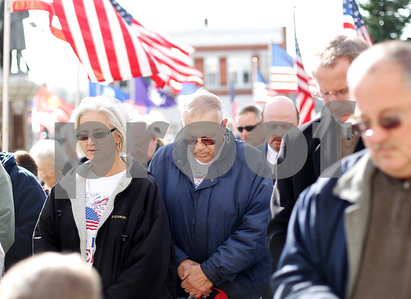 Beck Diefenbach  -  bdiefenbach@daily-chronicle.com<br /> <br /> Marine veteran Jerry Pelan, of Sycamore, prays during the invocation in the Veteran's Day observation in front of the DeKalb County Courthouse in Sycamore, lll., on Nov. 11, 2009.