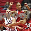 Beck Diefenbach  -  bdiefenbach@daily-chronicle.com<br /> <br /> Northern Illinois guard Jessie Wilcox (12) keeps control of the ball against Ball State guard Audrey McDonald (33) during the first half of the game at the NIU Convocation Center in DeKalb, Ill., on Wednesday Jan. 21, 2009.
