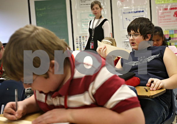 Beck Diefenbach  -  bdiefenbach@daily-chronicle.com<br /> <br /> 6th grader Austin Kosusnik attempts to decipher a sentence written in braille during the Braille Club meeting at Sycamore Middle School in Sycamore, Ill., on Thursday Jan. 22, 2008.