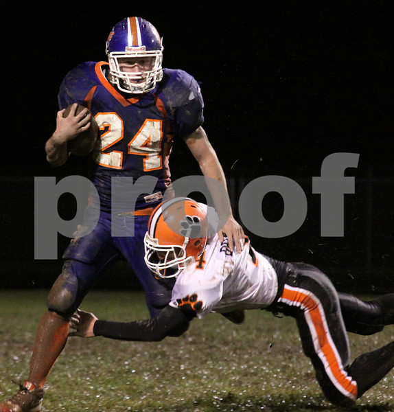 Wendy Kemp/For The Daily Chronicle<br /> Genoa-Kingston runningback Rob Thurlby gets tackled by Byron's Steven Bradley while returning a kickoff during Friday's playoff game.<br /> Genoa 10/23/09