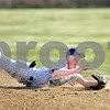 Beck Diefenbach  -  bdiefenbach@daily-chronicle.com<br /> <br /> Hinckley-Big rock's Jake Dunteman (31) dives for catch to end the top of the third inning of the game against Newark High School in Big Rock, Ill., on Thursday April 16, 2009.