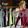 "Beck Diefenbach  -  bdiefenbach@daily-chronicle.com<br /> <br /> Kristin Flesher, of Genoa, searches through clothes at the hayes family garage sale in DeKalb, Ill., on Thursday June 18, 2009. Flesher, who visits garage sales weekly, said "" (I) never know what I'm gonna find when I come."""