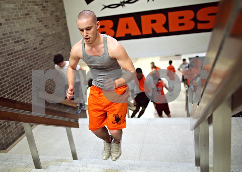 Beck Diefenbach – bdiefenbach@daily-chronicle.com<br /> <br /> DeKalb High School senior Kyle Wallin hops stairs with the rest of his team during practice at DeKalb High School in DeKalb, Ill., on Tuesday March 10, 2009.