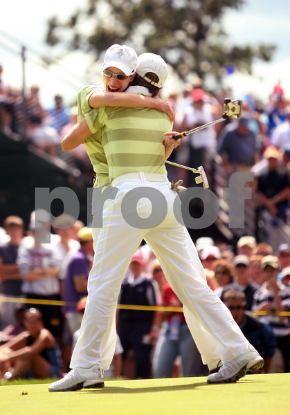 Beck Diefenbach  -  bdiefenbach@daily-chronicle.com<br /> <br /> Europe's Diana Luna embraces teammate Catriona Matthew after winning their match against USA at the Solheim Cup in Sugar Grove, Ill., on Saturday Aug. 22, 2009.