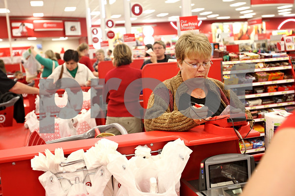 "Beck Diefenbach  -  bdiefenbach@daily-chronicle.com<br /> <br /> Darla Meador, of Cortland, pays for her purchase after shopping in the rebuilt Target Store in DeKalb, Ill., on Tuesday Oct. 6, 2009. ""It will be nice when (the crowds) calm down,"" Meador said."