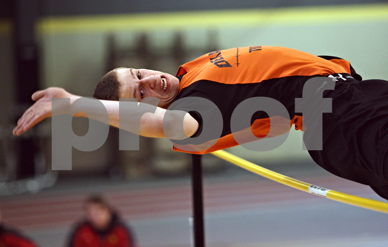 Beck Diefenbach  -  bdiefenbach@daily-chronicle.com<br /> <br /> DeKalb's Joe Martin attempts to leap over the bar in the high jump portion of the Western Sun Conference Invitational track and field meet at Sycamore High School in Sycamore, Ill., on Thursday March 19, 2009.