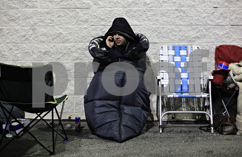 Beck Diefenbach  -  bdiefenbach@daily-chronicle.com<br /> <br /> Nick Stanfa, of Rochelle, orders a pizza while waiting overnight for Best Buy to open in DeKalb, Ill., on Friday Nov. 27, 2009. Stanfa was looking for deals on video games.