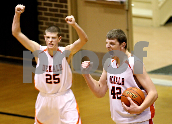 Beck Diefenbach  -  bdiefenbach@daily-chronicle.com<br /> <br /> DeKalb's Jordan Threloff (42, right) and Pat Rourke (25) celebrate a close win over Chicago Vocational at DeKalb High School in DeKalb, Ill., on Wednesday Dec. 23, 2009.
