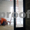 Beck Diefenbach  -  bdiefenbach@daily-chronicle.com<br /> <br /> Halbe Wynstra cleans the cement floor with a grinder at the new Sycamore Elementary School which is under construction in Sycamore, Ill., on Friday Jan. 23, 2009.
