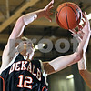 Beck Diefenbach  -  bdiefenbach@daily-chronicle.com<br /> <br /> DeKalb forward Cameron Calbow (12) grabs a rebound during the second quarter of the game against Kaneland at Kaneland High School in Maple Park, Ill., on Friday Jan. 23, 2009.