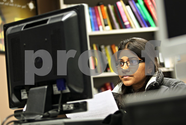 Beck Diefenbach  -  bdiefenbach@daily-chronicle.com<br /> <br /> Northern Illinois University graduate student Ashwini Pothula works on her resume at the University's Career Resource Center in the Campus Life Building in DeKalb, Ill., on Tuesday Feb. 3, 2009. Pothula also makes use of Victory eRecruiting (CQ), the University's online job posting site designed for student's and alumni.