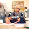 Beck Diefenbach  -  bdiefenbach@daily-chronicle.com<br /> <br /> Kevin Ballatine, 20, gets help on his chemistry homework from his father Dave, an NIU chemistry professor, at their DeKalb home on Friday April 17, 2009. Kevin is staying on as a full time student at NIU as he battles leukemia.