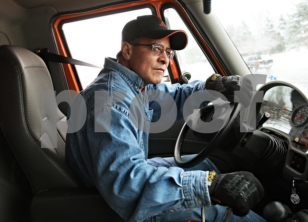Beck Diefenbach  -  bdiefenbach@daily-chronicle.com<br /> <br /> DeKalb snow plow driver Eddie Hernandez looks for traffic while clearing parts of Bethany Road in DeKalb, Ill., on Tuesday Dec. 22, 2009.