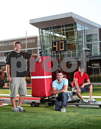 Beck Diefenbach  -  bdiefenbach@daily-chronicle.com<br /> <br /> From left, Craig Rusch, Britt Mork, and Chris Newquist with their invention the Cut Block Sled.