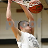 Rob Winner – rwinner@daily-chronicle.com<br /> Rob Winner – rwinner@kcchronicle.com<br /> Dave Dudzinski dunks Kaneland's first points of their game as the Knights hosted Glenbard South on Tuesday night.<br /> 12/01/2009