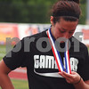 Randi Stella – rstella@daily-chronicle.com<br /> <br /> Sycamore's Nici Newquist looks down at her forth place medal during the 2A third place state tournament game at North Central College in Naperville, Ill., on Saturday, June 6th, 2009.