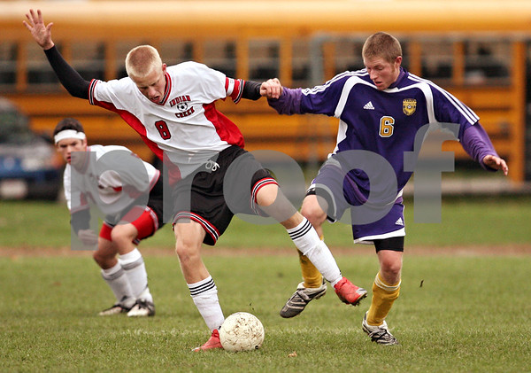 Beck Diefenbach  -  bdiefenbach@daily-chronicle.com<br /> <br /> Indian Creek's Matt Kyler (8) fights for the ball with Serena's Trevor Milam (6) during the second half of the class 1A regional match at Watermna Middle School in Waterman, Ill., on Wednesday Oct. 14, 2009. Serena defeated Indian Creek 1 to 0.