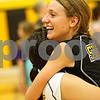 Beck Diefenbach  -  bdiefenbach@daily-chronicle.com<br /> <br /> Sycamore's Jillian Johnson (3, right), embraces Justine Schepler (8) after defeating DeKalb at Sycamore High School in Sycamore, Ill., on Thursday Oct. 15, 2009.