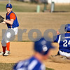 Beck Diefenbach  -  bdiefenbach@daily-chronicle.com<br /> <br /> Genoa Kingston's Jackson Kettner (1) looks towards first base after getting Burlington Central's Mike Rodriquez (24) out at second base during the top of the fifth inning at GK High School in Genoa, Ill., on Friday April 17, 2009.