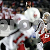 Rob Winner – rwinner@daily-chronicle.com<br /> Ball State quarterback Tanner Justice releases a pass just before taking a hit by Northern's Brandon Bice. NIU defeated Ball State 26-20 on Thursday night in DeKalb.<br /> 11/12/2009