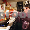 Beck Diefenbach – bdiefenbach@daily-chronicle.com<br /> <br /> Emily Lampkin, 20, of Sycamore, pours tomato sauce on meat she is cooking as she prepares dinner for her family at her home in Sycamore, Ill., on Thursday Feb. 19, 2009. Emily, who lives with Spina Bifida and Shunted Hydrocephalus, practices at home what she has learned at Life School.