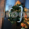 Beck Diefenbach  -  bdiefenbach@daily-chronicle.com<br /> <br /> Roses sit in the door handle to Cole Hall, the site of last year's shootings, on the campus of Northern Illinois University in DeKalb, Ill., Saturday Feb. 14, 2009.