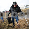 Beck Diefenbach  -  bdiefenbach@daily-chronicle.com<br /> <br /> DeKalb Park District Maintenance worker Steve Knutzen picks up trash in Pappas Park in DeKalb, Ill., on Friday Feb. 13, 2009. The clean-up is part of a the Park District's efforts to begin spring cleaning.